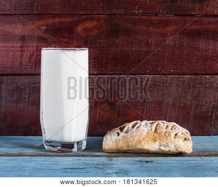 Glass of milk and oat cookies on the table.