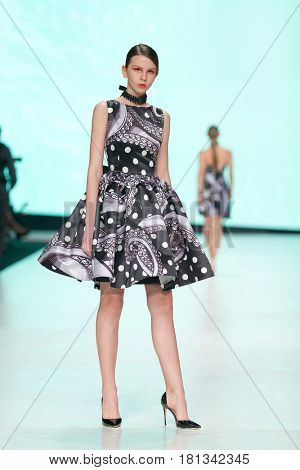 ZAGREB, CROATIA - APRIL 1, 2017: Fashion model wearing dress designed by Luka Grubisic from the spring/summer collection at the 'Fashion.hr' fashion show