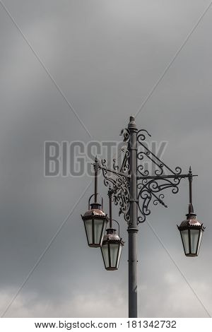 Auckland New Zealand - March 1 2017: Closeup of the iconic historic Three Lanterns on Ponsonby Road and College Hill Intersection. Dark gray rainy sky.