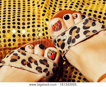 photo of pedicure like butterfly design on gold background close up, mani pedi creative concept stylish