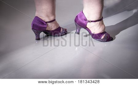 Woman dancing with salsa sandals. Lilac color