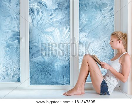 Woman Reading Book In Warm Room