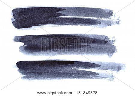 Set of grey ink brush strokes isolated on the white background