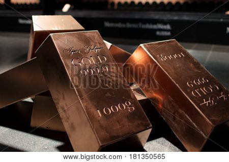 ST. PETERSBURG, RUSSIA - APRIL 1, 2017: Casts gold ingots illustrating the collection of Igor Gulyaev Highest Standard during Mercedes-Benz Fashion Day St. Petersburg