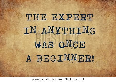 Inspiring motivation quote of the expert in anything was a beginner with typewriter text Turn Knowledge into Action. Distressed Old Paper with Typing image.