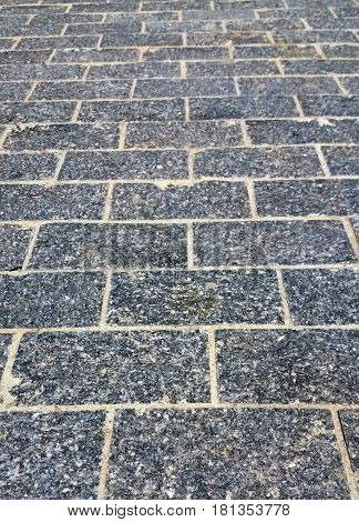 Detail of the old cobblestone street pavement