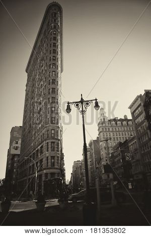 NEW YORK, USA - MARCH 24, 2017: The Flatiron Building is a triangular 22-story steel-framed landmark building in the borough of Manhattan, New York, is considered to be a groundbreaking skyscraper.