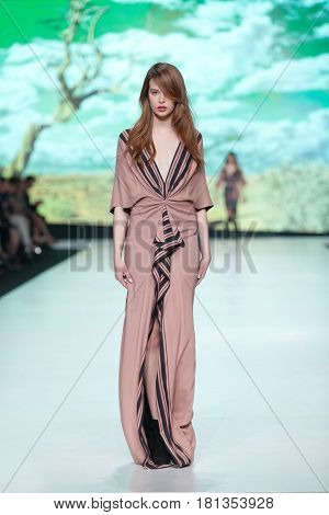 ZAGREB, CROATIA - APRIL 1, 2017: Fashion model wearing clothes designed by Ines Atelier from the spring/summer collection at the 'Fashion.hr' fashion show