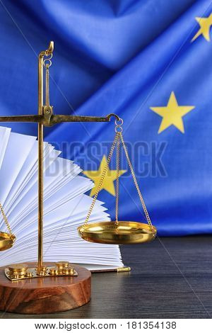 Scales and book on European Union flag background