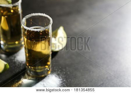 Tequila shot with salt on table, closeup