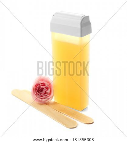 Liposoluble wax cartridge, wooden sticks and flower on white background