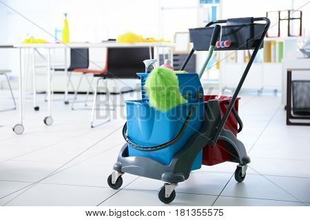 Janitor cart with tools for cleaning in office