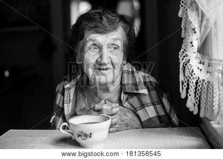 An elderly woman black and white portrait.