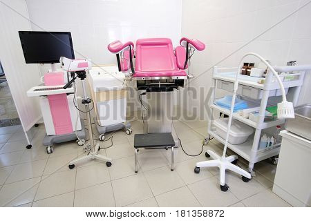 gynecological chair and other medical equipment in a gynecological office