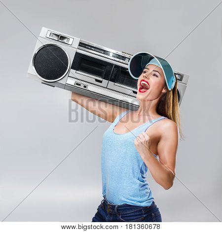 Young Happy Woman With Boombox