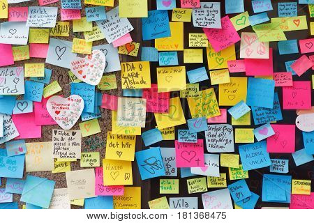 STOCKHOLM SWEDEN - APR 12 2017: Lots of messages on colorful notes in central Stockholm where the lorry crashed from people paying respect to the victims in the terror attack in Stockholm April 07 2017. April 13 2017 in Stockholm Sweden
