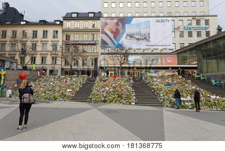 STOCKHOLM SWEDEN - APR 12 2017: Lots of flowers in central Stockholm from people paying respect to the victims in the terror attack in Stockholm April 07 2017. April 13 2017 in Stockholm Sweden