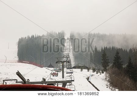 Skiers and snowboarders enjoying on slopes of ski resort Bukovel Ukraine.