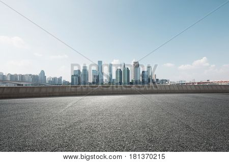 cityscape of chongqing from empty asphalt road