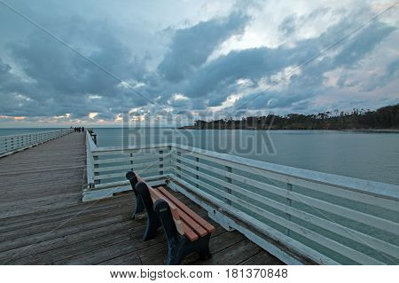 Bench on San Simeon Public Pier at sunset on the Central Coast of California USA