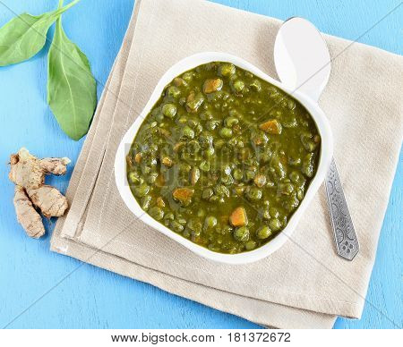 Palak curry, an Indian vegetarian food made from spinach, carrot and other items, is a healthy side dish for cuisines like chapati and roti.