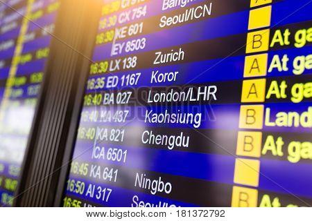 Departures display board at airport terminal