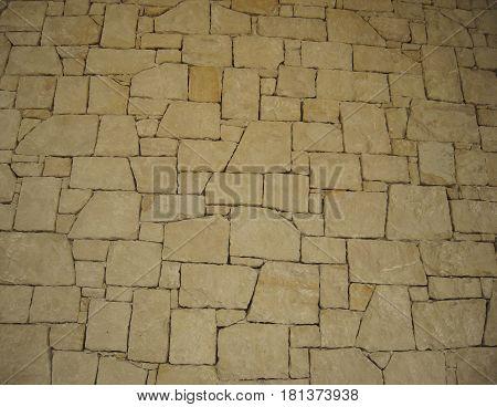 Masonry, stonework, classic stone texture, nature sand color.
