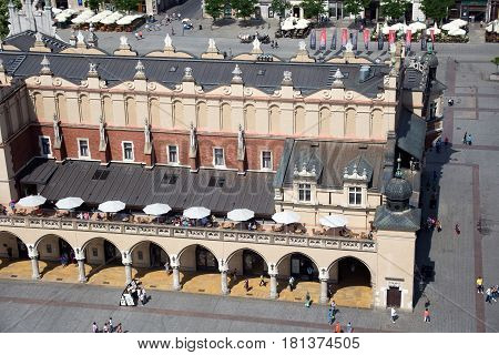 KRAKOW, POLAND - MAY 29, 2016: Part of the famous Cloth Hall called Sukiennice at the Main Market Square in historical center of Krakow.