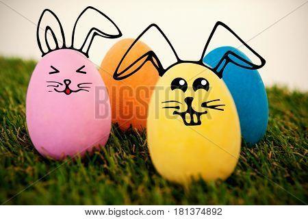 easter eggs arranged on grass