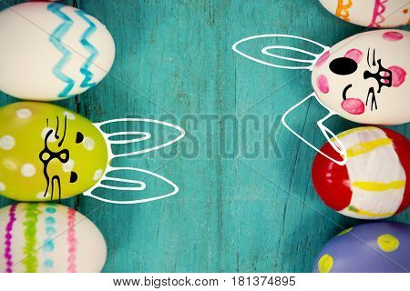 against various easter eggs arranged on wooden surface
