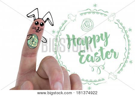 Digitally generated image of fingers painted as Easter bunny against easter greeting