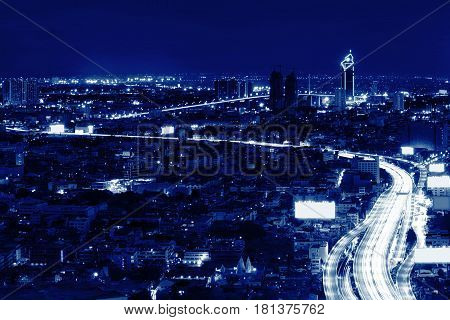 road in Sathorn District at night Bangkok Thailand
