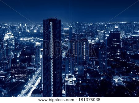 Skyscrapers in Sathorn District at night in Bangkok Thailand
