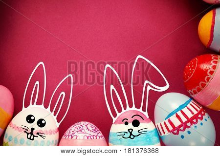PE047_butterfly_02_bs_nf against various easter eggs arranged on pink background