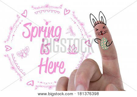 Digitally composite image of fingers representing Easter bunny against easter greeting