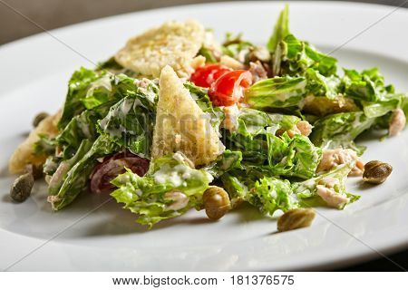 Diet Restaurant Food -Tuna Salad with Tomato and Capers. Healthy Low-fat Salad