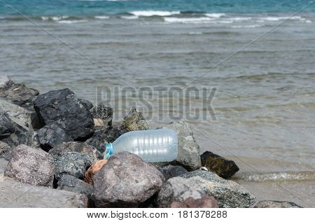 Large Water Bottle Waste On Rocky Seashore