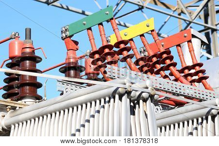large ceramic insulators of a high-voltage transformer in the power plant of solar energy production