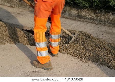 Man At Work With Orange Pants In The Site