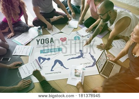 Yoga class people discussing different positions