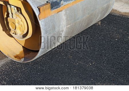 Road Roller And The Black Asphalt Of The New Street