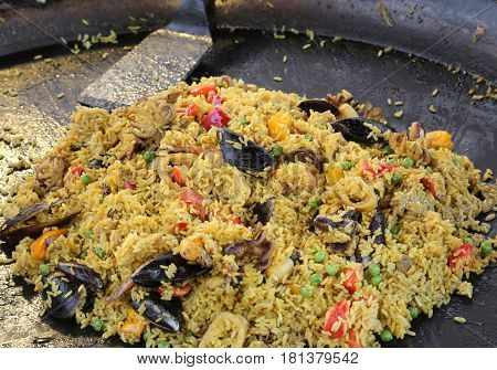 Pan Of Spanish Restaurant With Tasty Paella With Yellow Rice And