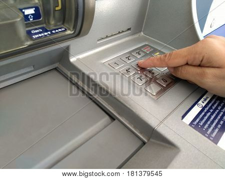 ATM machine keypad numbers Entering atm cash machine pin code Technology background