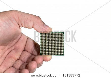 The processor in the person's hand on a white background