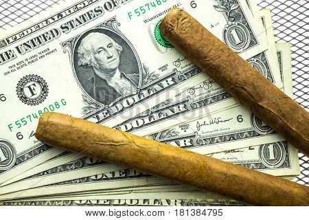 Two cuban cigars and dollar money detail