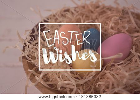 Easter greeting against colorful easter eggs in the nest