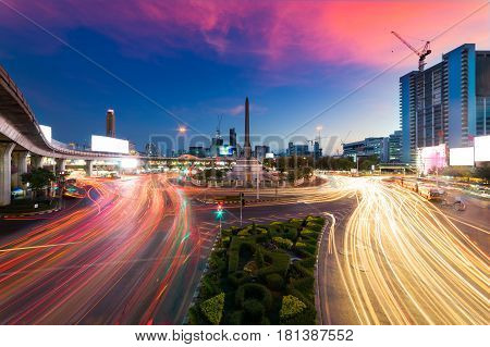 Sunset scence of Bangkok Panorama Thailand victory monument km 0 and main traffic for road in Bangkok city downtown with sunset sky and clouds