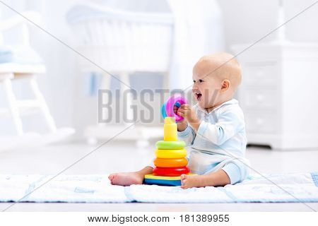 Baby Playing With Toy Pyramid. Kids Play