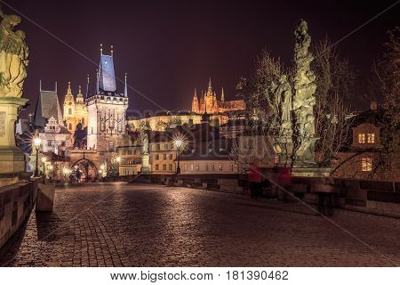 Night shot of famous Charles Bridge shot with long exposure and star shaped lamps, Prague,Czech Republic.
