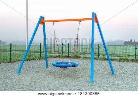 Children's playground. Swing on a playground in a city park.